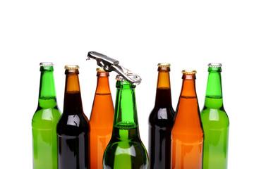 Opener. Bottlenecks. Bottles of beer. Close up.