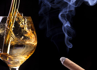 Cognac or brandy on a black with cigar smoke