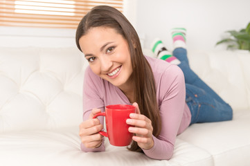 Women with cup of coffee. Cheerful young women drinking coffee a