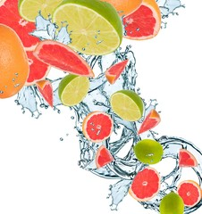 Fresh citrus falling in water splash