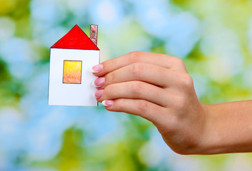 concept: woman hand with paper house