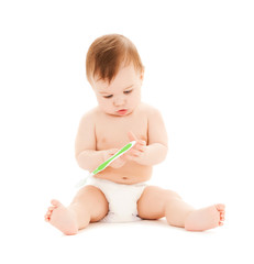 curious baby brushing teeth