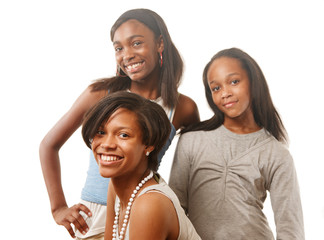 Happy African American teenage girls on white
