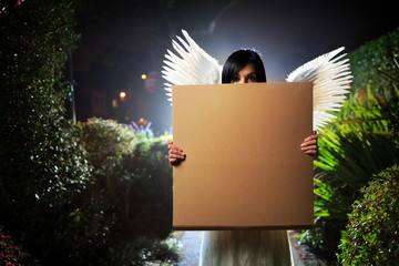 Angel woman with cardboard sign