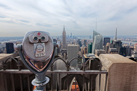 Binoculars looking down to the Empire State building in New York