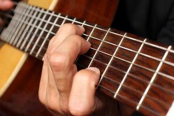 musician playing an acoustic guitar