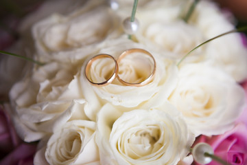two wedding rings on flowers close-up