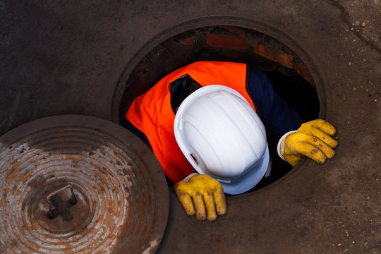 Worker Going Down The Manhole