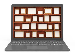 Modern Laptop with Empty Photo Frames on Wooden Shelf
