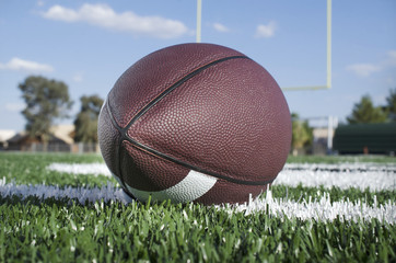 American football with goal post background