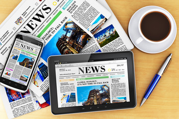 Tablet computer, smartphone and newspapers