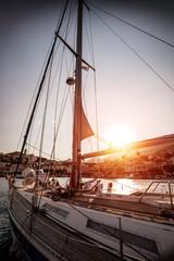 Luxury sailboat in sunset