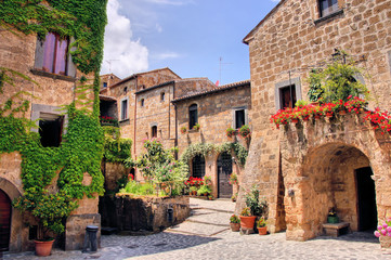 Fotobehang - Picturesque corner of a quaint hill town in Italy