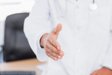 Doctor presenting his hand for a handshake
