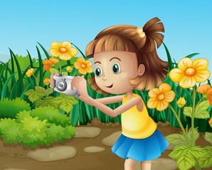 A girl taking photos at the garden