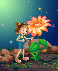 A small girl watering the giant plant