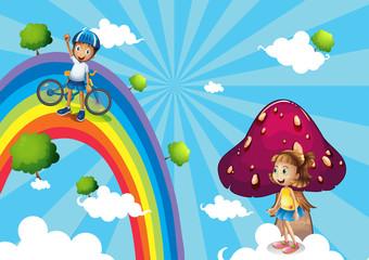A boy biking in the rainbows
