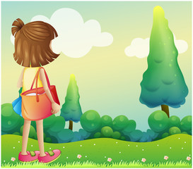 A girl with a bag at the hilltop