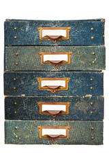 Group of vintage filing drawers with empty labels