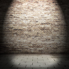 red brick wall background in basement with beam of light