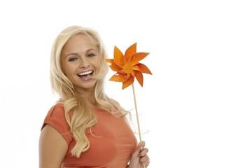 Happy woman holding pinwheel