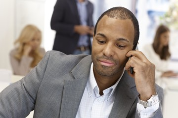 Closeup portrait of businessman on phone call
