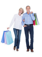 Mature Couple Holding Shopping Bags