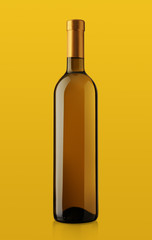 bottle of white wine on yellow background