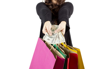 woman with a lot of shopping bags and dollars