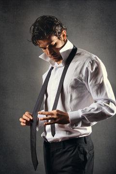 Fashion model wearing a black tie