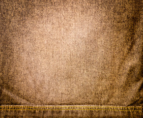 Abstract background.Brown striped jeans with sewing a seam.For t