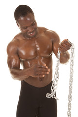 Strong man with chain holding