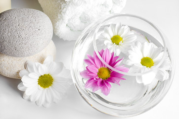 spa decoration with stones and daisies