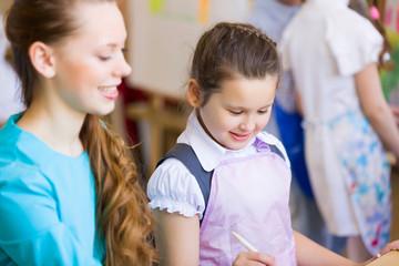 Cute girl and teacher