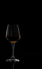 Wine glass in blackdrop