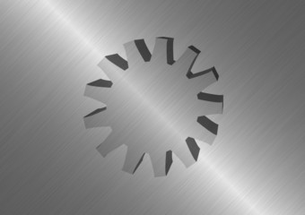 Polished metal background with protruding metal wheel
