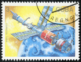 stamp shows a spaceships Mir and Kvant space link
