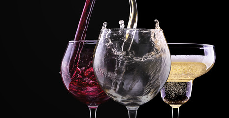 Elegant red wine glass in black background