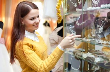 girl chooses bridal accessories