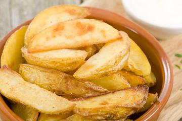 Potato Wedges - Crispy potato wedges served with aioli.