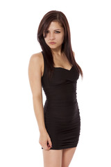 Young woman in a little black dress is very mad.