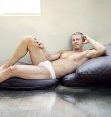 Man lying on pillows