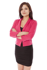 Young Hawaiian woman in business outfit stands with arms crossed
