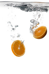 Healthy Orange slices with water splashes isolated on white