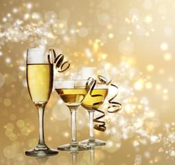 Glasses on Golden Sparkling Background