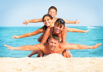 Wall Mural - Happy Family Having Fun at the Beach. Summer Holidays