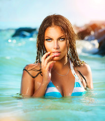 Beauty Sexy Model Girl Swimming and Posing in the Sea
