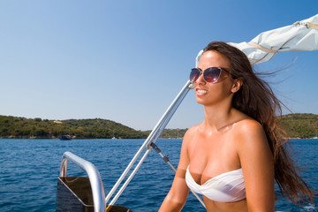 young woman driving a speedboat