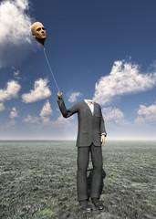 Head less man holds balloon head