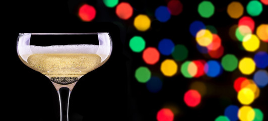 glass of champagne isolated on party background